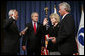 "President George W. Bush attends the ceremonial swearing-in of Mary Peters as the 15th U.S. Secretary of Transportation, Tuesday, Oct. 17, 2006 at the Department of Transportation in Washington, D.C., as White House Chief of Staff Josh Bolten administers the oath of office and Peter's husband, Terryl ""Terry"" Peters, Sr. holds the bible. White House photo by Paul Morse"