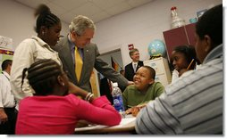 President George W. Bush spends time with students at the Waldo C. Falkener Elementary School Wednesday, Oct. 18, 2006, in Greensboro, N.C. The President visited with third- and fifth-graders before delivering his remarks on the No Child Left Behind Act. White House photo by Paul Morse