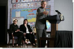 "President George W. Bush delivers remarks Wednesday, Oct. 18, 2006, on No Child Left Behind during a visit to the Waldo C. Falkener Elementary School in Greensboro, N.C. The President congratulated the school's principal, teachers and the parents for ""working hard to make this a fantastically interesting place for our children to go to school."" Seated in the background are Secretary of Education Margaret Spellings and Dr. Amy Holcombe, Principal of the school.  White House photo by Paul Morse"
