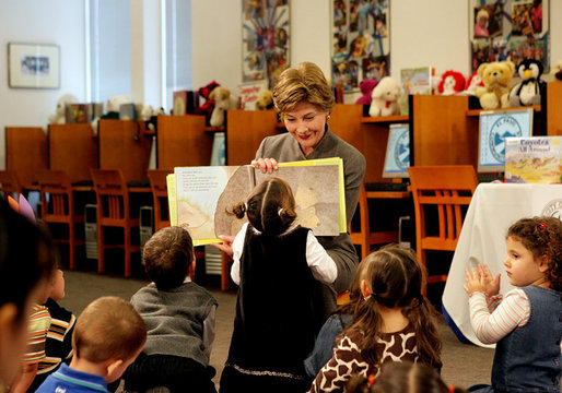 "A little reader takes a closer look as Mrs. Laura Bush reads the children's book, ""I Love You, Little One,"" by Nancy Tafuri during a visit to the Jenna Welch and Laura Bush Community Library in El Paso, Texas, Wednesday, Oct. 18, 2006. Since the library opened in 2003, the number of programs and attendance has tripled. Through the past year, the Library hosted 349 programs for more than 10,000 participants. White House photo by Shealah Craighead"