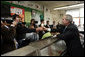 President George W. Bush is handed an ice cream cone during a visit to Manning's Ice Cream and Milk in Clarks Summit, Pa., Thursday, Oct. 19, 2006. White House photo by Paul Morse