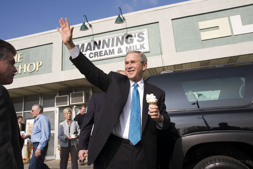 With ice cream in hand, President George W. Bush departs Manning's Ice Cream and Milk in Clarks Summit, Pa., Thursday, Oct. 19, 2006. White House photo by Paul Morse