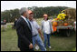 President George W. Bush talks with pumpkin roadside stand owner Bill Gaulmyer and Thina Patterson in Richmond, Va., Thursday, Oct. 19, 2006. White House photo by Paul Morse