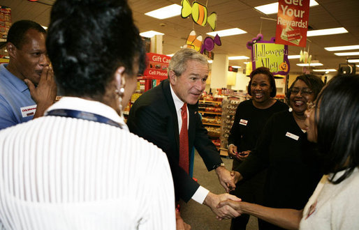 "President George W. Bush meets employees at a pharmacy in Washington, D.C. Friday, Oct. 20, 2006, during a visit to the store where he talked about the Medicare Part D Plan. ""Our seniors are saving money, they're getting better coverage,"" said the President. ""It's a plan that I'm real proud of."" White House photo by Kimberlee Hewitt"