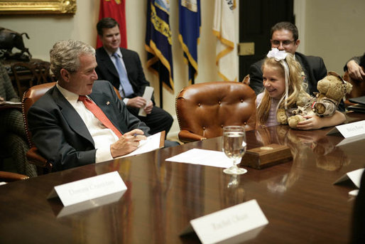 President George W. Bush listens to Bailey Reese, 10, founder of Hero Hugs, which sends care packages to our troops serving overseas, during a meeting with organizations that support the U.S. Military in Iraq and Afghanistan in the Roosevelt Room, Friday, October 20, 2006. White House photo by Eric Draper