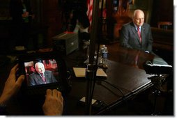 Vice President Dick Cheney is seen on a TV monitor during a radio and television interview with Sean Hannity of FOX News in the Vice President's Ceremonial Office, Tuesday, October 24, 2006.  White House photo by David Bohrer