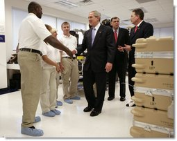 President George W. Bush shakes hands with employees at Gyrocam Systems in Sarasota, Fla., Tuesday, Oct. 24, 2006, during a visit that highlighted technology to help soldiers fight the war on terrorism. White House photo by Eric Draper