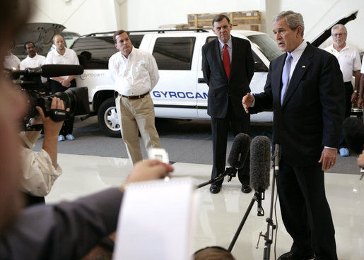 "President George W. Bush speaks to the media after an unannounced visit Tuesday, Oct. 24, 2006, to Gyrocam Systems in Sarasota, Fla. Speaking to the business's entrepreneurial spirit, the President said, ""It is strong inside this company, and we intend to keep it strong by keeping taxes low, less regulation, hopefully less lawsuits, and our economy will remain strong."" White House photo by Eric Draper"