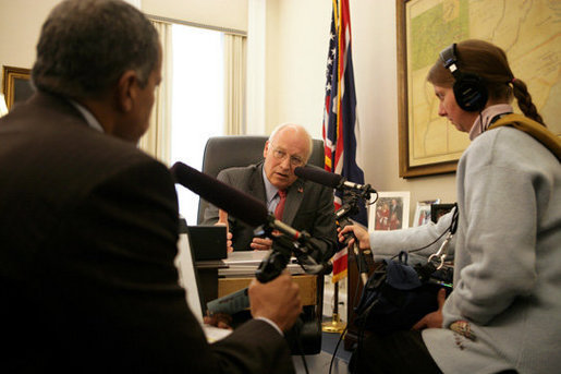 Vice President Dick Cheney talks with Juan Williams, left, of National Public Radio during a taped radio interview in the Vice President's office during the White House Radio Day, Tuesday, October 24, 2006. White House photo by David Bohrer