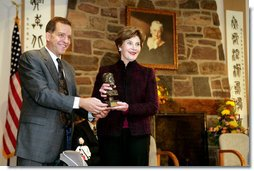 John Long, Chairman of the Board of Directors, Pearl S. Buck International, presents Mrs. Laura Bush with the 2006 Pearl S. Buck Woman of the Year award Tuesday, October 24, 2006, at the Pearl S. Buck House in Perkasie, Pennsylvania. The Pearl S. Buck award is given to honor women who make outstanding contributions in the areas of cross-cultural understanding, humanitarian outreach, and improving the life and expanding opportunities for children around the world. White House photo by Shealah Craighead