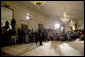 "President George W. Bush walks into the East Room for a press conference in Wednesday, Oct. 25, 2006. ""Our security at home depends on ensuring that Iraq is an ally in the war on terror and does not become a terrorist haven like Afghanistan under the Taliban,"" said President Bush. White House photo by Paul Morse"