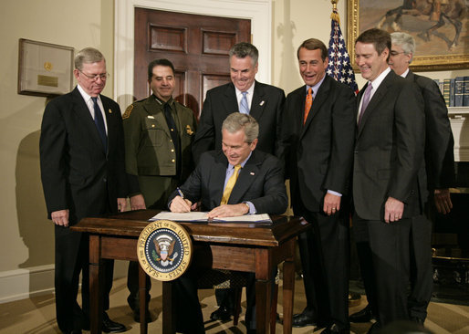 President George W. Bush signs H.R. 6061, the Secure Fence Act of 2006, in the Roosevelt Room Thursday, Oct. 26, 2006. Pictured with the President are, from left: Commissioner Ralph Basham of U.S. Customs and Border Protection; Chief David Aguilar of U.S. Customs and Border Protection; Congressman Peter King, R-N.Y.; Congressman John Boehner, R-Ohio; and Deputy Secretary Michael Jackson of the Department of Homeland Security; and Senator Bill Frist, R-Tenn. White House photo by Kimberlee Hewitt