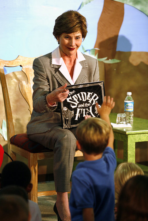 "Mrs. Laura Bush calls on a young member of the audience to speak after she finished reading the book, ""The Spider and the Fly"" by Mary Howitt, illustrated by Tony DiTerlizzi, during a visit to the West Palm Beach Public Library in West Palm Beach, Fla., Friday, Oct. 27, 2006. The Library began its reading room in a congregational church in 1894, and has grown to have over one hundred-thousand books in their collection. White House photo by Shealah Craighead"