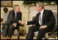 President George W. Bush welcomes NATO Secretary-General Jaap de Hoop Scheffer to the Oval Office Friday, Oct. 27, 2006. White House photo by Kimberlee Hewitt