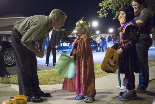 President George W. Bush shares a moment with a king during a Halloween night stop Tuesday, Oct. 31, 2006, at a housing development on base at Robins Air Force Base, Ga. White House photo by Paul Morse