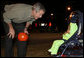 President George W. Bush greets a trick-or-treating frog Tuesday, Oct. 31, 2006, during an unscheduled stop on base at Robins Air Force Base in Warner Robins, Ga. White House photo by Paul Morse