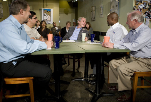 President George W. Bush talks with small business owners before delivering a live Radio Address from the Mile High Coffee shop in Englewood, Colorado, Saturday, Nov. 4, 2006. White House photo by Eric Draper