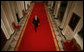 President George W. Bush walks through Cross Hall en route to the East Room of the White House Wednesday, Nov. 8, 2006, from where he spoke to the nation regarding Tuesday's election. White House photo by Paul Morse