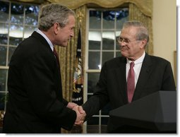 President George W. Bush shakes the hand of outgoing Secretary of Defense Donald Rumsfeld Wednesday, Nov. 8, 2006, in the Oval Office where the President announced the Secretary's resignation and his intention to nominate Dr. Robert Gates as successor. White House photo by Paul Morse