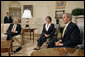 "President George W. Bush meets with Congresswoman Nancy Pelosi (D-Calif.) and Congressman Steny Hoyer (D-Md.) in the Oval Office Thursday, Nov. 9, 2006. ""First, I want to congratulate Congresswoman Pelosi for becoming the Speaker of the House, and the first woman Speaker of the House. This is historic for our country,"" President Bush said. He also stated, ""This is the beginning of a series of meetings we'll have over the next couple of years, all aimed at solving problems and leading the country."" White House photo by Eric Draper"