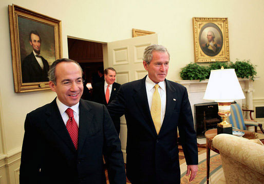 President George W. Bush welcomes President-elect Felipe Calderon of Mexico to the Oval Office Thursday, Nov. 9, 2006. White House photo by Eric Draper