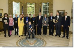 President George W. Bush and Mrs. Laura Bush stand with the recipients of the 2006 National Medal of Arts in the Oval Office Thursday, Nov., 9, 2006. Pictured from left, they are: Ben Jaffe and his mother Sandra Jaffe, director and co-founder of the Preservation Hall Jazz Band; Literary Translator Gregory Rabassa; Dancer Cyd Charisse; Photographer Roy DeCarava; Industrial Designer Viktor Schreckengost; Musician Dr. Ralph Stanley; Arts patron Billie Holladay; Composer William Bolcom; Interlochen Center for the Arts CEO Jeffrey Kimpton; and NEA Chairman Dana Gola. White House photo by Paul Morse