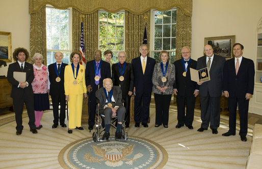 President George W. Bush and Mrs. Laura Bush stand with the recipients of the 2006 National Medal of Arts in the Oval Office Thursday, Nov., 9, 2006. Pictured from left, they are: Ben Jaffe and his mother Sandra Jaffe, director and co-founder of the Preservation Hall Jazz Band; Literary Translator Gregory Rabassa; Dancer Cyd Charisse; Photographer Roy DeCarava; Industrial Designer Viktor Schreckengost; Musician Dr. Ralph Stanley; Arts patron Billie Holladay; Composer William Bolcom; Interlochen Center for the Arts CEO Jeffrey Kimpton; and NEA Chairman Dana Gioia. White House photo by Paul Morse