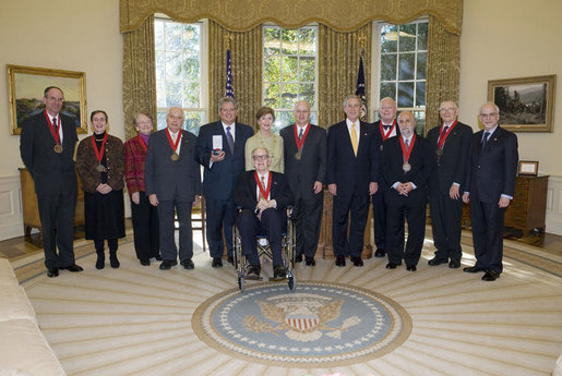 President George W. Bush and Mrs. Laura Bush stand with the 2006 National Humanities Medal recipients in the Oval Office Thursday, Nov., 9, 2006. Pictured from left, they are: Mark Noll, historian of religion; Mary Lefkowitz, classicist; Meryle Secrest, biographer; Bernard Lewis, Middle Eastern scholar; John Raisian senior fellow and director of the Hoover Institution; Robert Fagles, translator and classicist; Nickolas Davatzes, historian; Kevin Starr, historian; Fouad Ajami, Middle Eastern studies scholar; James Buchanan, economist; and NEH chairman Bruce Cole. White House photo by Paul Morse