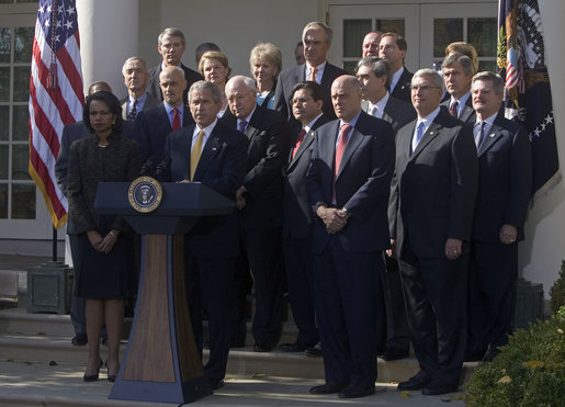 "President George W. Bush stands with his Cabinet during a Rose Garden address to the media. ""As the new members of Congress and their leaders return to Washington, I've instructed my Cabinet to provide whatever briefings and information they need to be able to do their jobs,"" said the President. ""The American people expect us to rise above partisan differences, and my administration will do its part."" White House photo by David Bohrer"