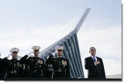 President George W. Bush joins, from left, U.S. Marine Corps Lt. Gen. James Amos; Chairman of the Joint Chiefs of Staff General Peter Pace and Commandant of the Marine Corps, General Michael Hagee, during the National Anthem at the dedication ceremony of the National Museum of the Marine Corps Friday, Nov. 10, 2006, in Quantico, Va. White House photo by Paul Morse
