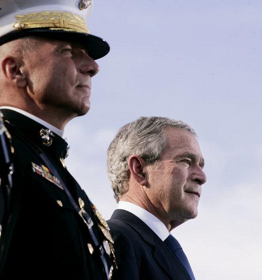 President George W. Bush stands with Commandant of the Marine Corps, General Michael Hagee, at the dedication ceremony of the National Museum of the Marine Corps Friday, Nov. 10, 2006, in Quantico, Va. White House photo by Paul Morse