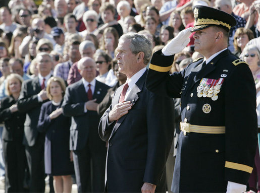 President George W. Bush is joined by Major General Guy Swan III, Commander of the Joint Force Headquarters National Capital Region & U.S. Army Military District of Washington, during the Veteran's Day ceremonies Saturday, Nov. 11, 2006, at Arlington National Cemetery in Arlington, Va. White House photo by Kimberlee Hewitt
