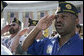 Veterans from the American Legion Post Thurmont, Md., salute during Veteran's Day ceremonies Saturday, Nov. 11, 2006, at Arlington National Cemetery in Arlington, Va., where President George W. Bush lay a wreath at the Tomb of the Unknowns, and addressed veterans, their family members and guests. White House photo by Kimberlee Hewitt