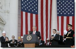 President George W. Bush is applauded as he addresses the Veteran's Day ceremonies Saturday, Nov. 11, 2006, at Arlington National Cemetery in Arlington, Va.  White House photo by Kimberlee Hewitt