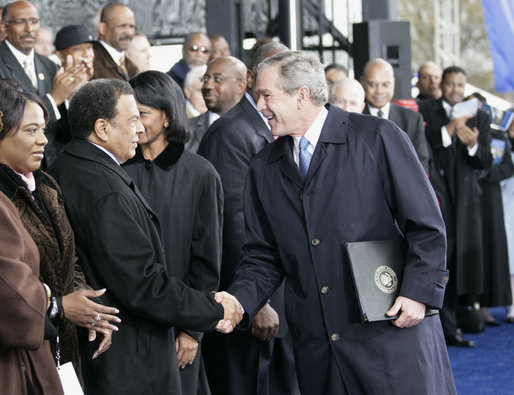 President George W. Bush greets former United Nations Ambassador Andrew Young Monday, Nov. 13, 2006, following President Bush's speech at the groundbreaking ceremony for the Martin Luther King Jr. National Memorial on the National Mall in Washington, D.C. White House photo by Eric Draper