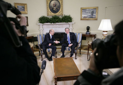 President George W. Bush and Israeli Prime Minister Ehud Olmert shake hands during a brief question and answer opportunity with members of the media Monday, Nov. 13, 2006, in the Oval Office at the White House. White House photo by Eric Draper