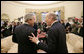 President George W. Bush and Israeli Prime Minister Ehud Olmert stand together talking following their meeting with members of the media Monday, Nov. 13, 2006, in the Oval Office at the White House. White House photo by Eric Draper