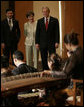President George W. Bush and Mrs. Laura Bush are joined by Dr. Vivian Balakrishnan as they watch a traditional gamelan musical performance Thursday, Nov. 16, 2006, at the Asian Civilisations Museum in Singapore. White House photo by Paul Morse