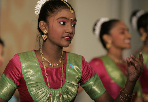 A student from the Bukit View Primary School in Singapore performs a cultural dance with classmates for President George W. Bush and Mrs. Laura Bush during their visit Thursday, Nov. 16, 2006, to the city's Asian Civilisations Museum. White House photo by Paul Morse