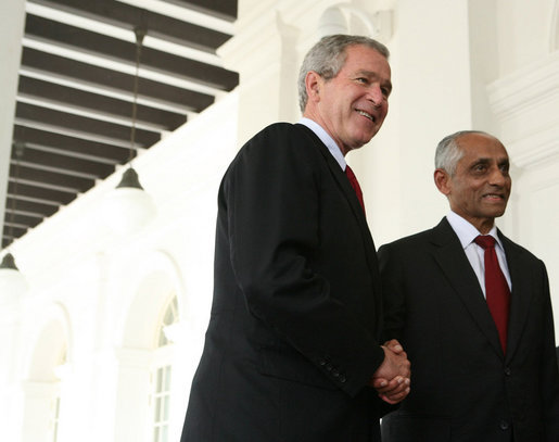 President George W. Bush is welcomed to Istana, the presidential palace, by Singapore's Acting President J.Y. Pillay, Thursday, Nov. 16, 2006. White House photo by Paul Morse