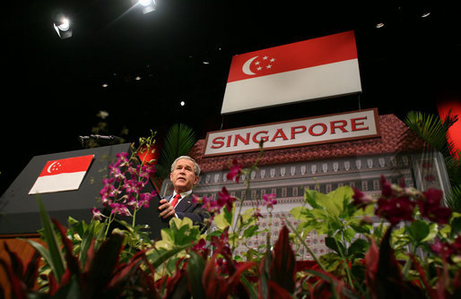 "President George W. Bush delivers remarks during a visit Thursday, Nov. 16, 2006, to the National University of Singapore. The President told the audience, ""Our roots, America's roots in Singapore are deep and enduring."" White House photo by Paul Morse"