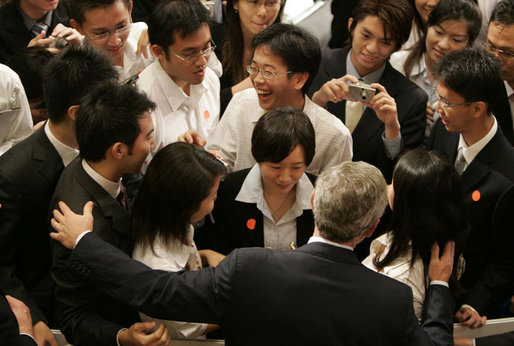 President George W. Bush greets students after delivering remarks Thursday, Nov. 16, 2006, at the National University of Singapore. White House photo by Paul Morse