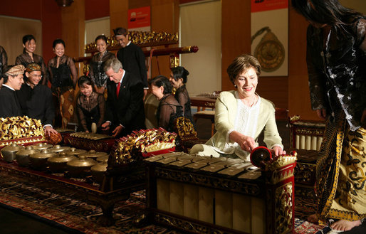 President George W. Bush and Laura Bush create their own music after a traditional gamelan musical performance Thursday, Nov. 16, 2006, at the Asian Civilisations Museum in Singapore. The Bushes are scheduled to depart Singapore on Friday for Vietnam and the 2006 APEC Summit. White House photo by Paul Morse