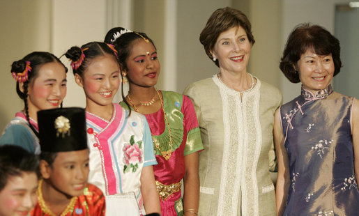 Mrs. Laura Bush stands with Jenny Law, principal of the Bukit View Primary School in Singapore, as they pose with student members of the Bukit View Primary School dance troupe Thursday, Nov. 16, 2006. The kids performed for President George W. Bush and Mrs. Bush during a visit Thursday morning to the Asian Civilisations Museum. White House photo by Paul Morse