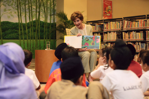 Mrs. Laura Bush reads Miss Spider's Tea Party during her visit Thursday, Nov. 16, 2006, to the National Library Building's Children's Reading Room in Singapore. Afterward, Mrs. Bush participated in a brief question-and-answer session with the kids. White House photo by Shealah Craighead