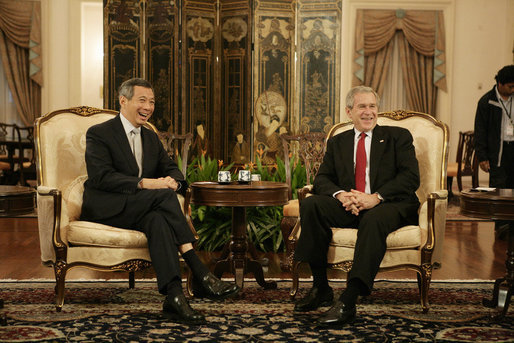 "President George W. Bush and Prime Minister Lee Hsien Loong of Singapore, smile for the cameras Thursday, Nov. 16, 2006, during a visit by President Bush to Istana, the presidential palace, in Singapore. The two had ""a wide-ranging discussion,"" according to the President, during which they discussed economics and terrorism. White House photo by Eric Draper"