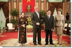 President George W. Bush and Mrs. Laura Bush join Viet President Nguyen Minh Triet and Mrs. Tran Thi Kim Chi in the Great Hall of the Presidential Palace Friday, Nov. 17, 2006, after arriving in Hanoi for the 2006 APEC Summit.  White House photo by Eric Draper