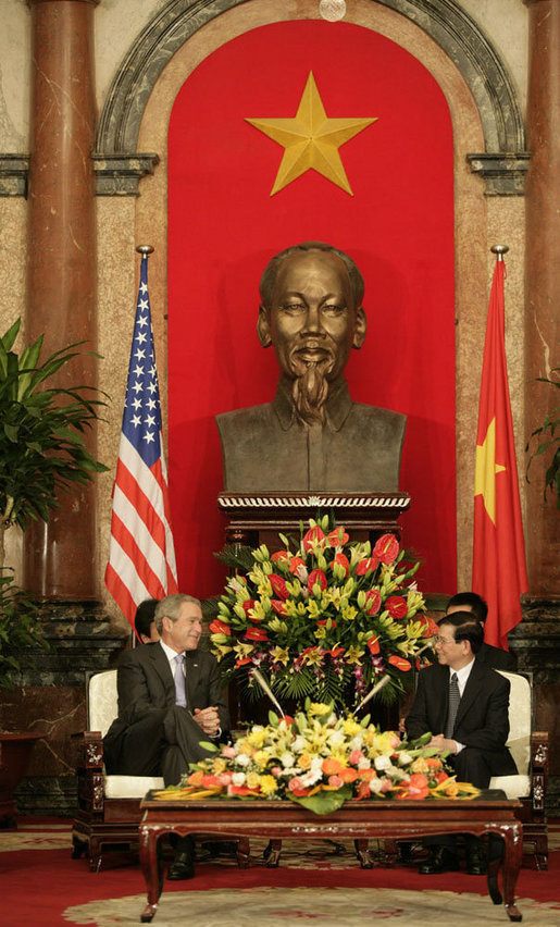 "President George W. Bush and Viet President Nguyen Minh Triet meet in the Great Hall of the Presidential Palace in Hanoi Friday, Nov. 17, 2006. President Bush told his host, ""I've been reading and studying about your country and I have seen now firsthand the great vibrancy and the excitement that's taking place in Vietnam."" White House photo by Eric Draper"