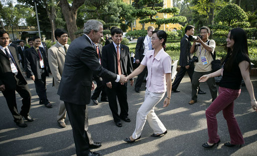 President George W. Bush greets passersby as he walks from Hanoi's Presidential Palace Friday, Nov. 17, 2006, to the Office of the Government where he met with Viet Prime Minister Nguyen Tan Dung. White House photo by Eric Draper