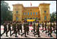 An honor guard passes by the Presidential Palace in Hanoi Friday, Nov. 17, 2006, during the arrival ceremony for President George W. Bush and Mrs. Laura Bush. White House photo by Paul Morse